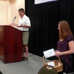 A.J. King announces the rafting award winners while Laura Welker hands out prizes.