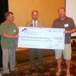 ICBA chairman-elect Bill Loving presents MIB with a sizeable royalty check.